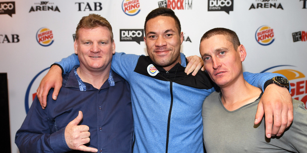 Duco Event's Dean Lonergan and David Higgins with Joseph Parker at a press conference in May. Photo / Andrew Cornaga of Photosport