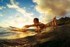 Head to the beach in Waikiki and learn to surf. Photo / 123RF