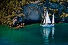 Sail Barbary near the Mine Bay Maori Rock Carvings, Lake Taupo.
