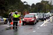 Traffic is turned around at Puhoi after a serious crash has blocked SH1 near Warkworth. Photo / Dean Purcell