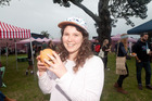 Lilli Matthews tries a vegetarian burger at the festival. Photo/Andrew Warner