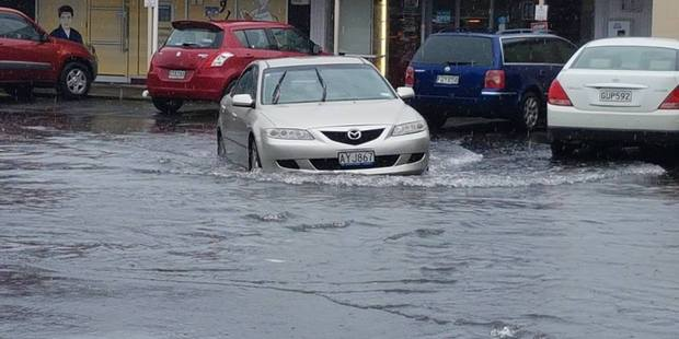 A car drives through flooding in Browns Bay, Auckland, over the weekend during heavy rain. Photo/file