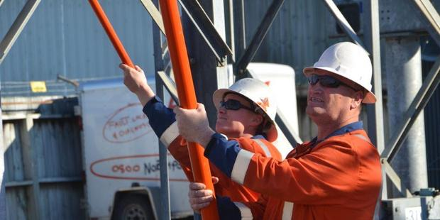 Michelle Burke and Neville Knight at work for lines company NorthPower. Photo / Supplied