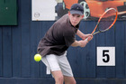 Wellington's Sam Newman, aims to put a two-handed hit past New Plymouth's Caleb Fleming in the men's final of the Wanganui Open yesterday.