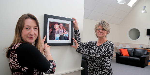 Whanganui Plunket committee member Lisa Rodgers (left) and Bronwyn Kendrick hold a photograph of Lenore Stewart. PHOTO/ BEVAN CONLEY