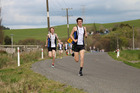Christian Conder leading at the halfway point of the Harrier club's One Mile Race on Saturday.