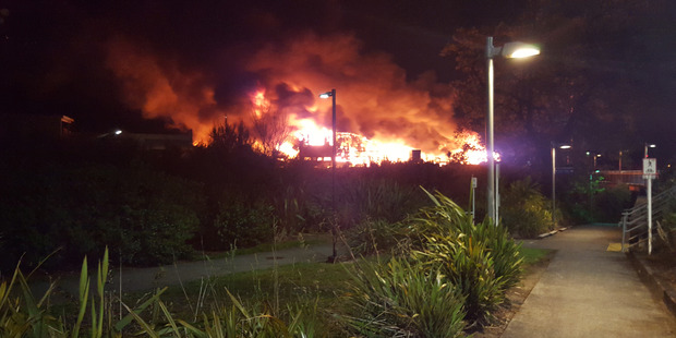 Loading At its height 26 crews with more than 100 firefighters were at the Henderson blaze. Photo / Facebook