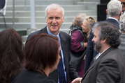 James Cameron, left, and Sir Peter Jackson mingle with guests after the swearing-in ceremony for the Governor General, Dame Patsy Reddy, at Parliament. Photo / Mark Mitchell.
