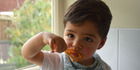 Child health expert Julie Bhosale's son, Sahan, 20 months, tucks into one of her meals. Photo / Supplied