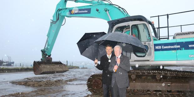 GROUNDBREAKING: Spirits high for Stuart Crosby and Philip Sherry despite rain as construction launch of new Tauranga marine hub gets underway. PHOTO/SUPPLIED