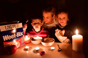 Dinner by candle light: A South Australia family dealing with the state-wide power outage. Photo /  Keryn Stevens