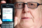 Trevor Dickason with one of the scam text messages he received. PHOTO/STUART MUNRO