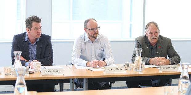 Councillors Matt Cowley, Steve Morris and Bill Grainger at a hearing panel to listen to owners object to their dog being classified as menacing. Photo/John Borren