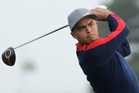 United States' Rickie Fowler hits a drive on the third hole during a foresomes match at the Ryder Cup golf tournament. Photo / AP