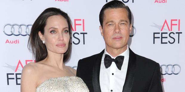 Angelina Jolie has chosen to avoid any contact with Brad Pitt by blocking his phone number. Photo / AP