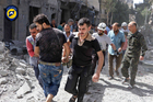 Rescue workers work the site of airstrikes in al-Mashhad neighborhood in the rebel-held part of eastern Aleppo, Syria. Photo / AP