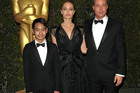 Angelina Jolie and Brad Pitt, pictured with son Maddox, have filed for divorce. Photo/John Shearer/AP