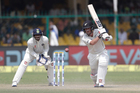 New Zealand's Luke Ronchi, right, plays a shot on the third day of their cricket test match against India at Green Park Stadium in Kanpur, India, Saturday, Sept. 24, 2016. Photo / AP.