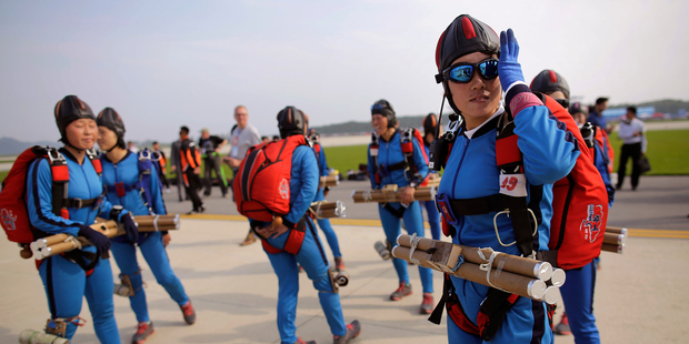 North Korean female parachutists prepare to board a helicopter. Photo / AP