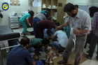 Victims of an airstrike receive treatment on the floor of a clinic in Aleppo, Syria. Photo / AP