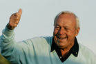 This 2007 file photo shows former Masters champion Arnold Palmer acknowledging the crowd after hitting the ceremonial first tee shot prior to the first round of the 2007 Masters. Photo / AP.