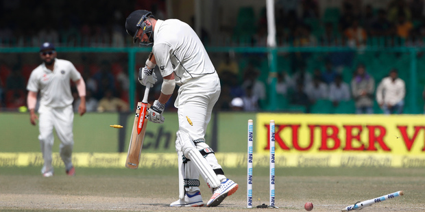 Mark Craig is bowled out by India's Mohammed Shami on the fifth day of their first cricket test match against India in Kanpur. Photo / AP