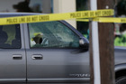 A cars windows are shattered by bullets at the scene of a shooting in Houston. Photo / AP