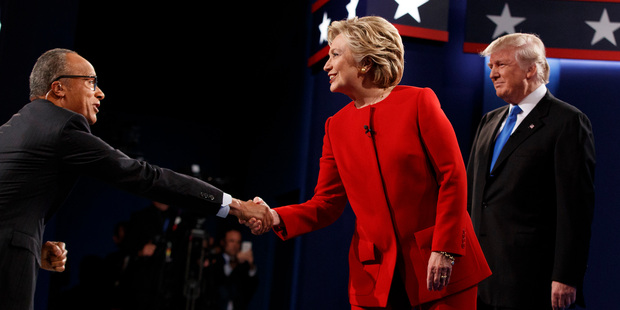 Loading Hillary Clinton shakes hands with moderator Lester Holt. Photo / AP