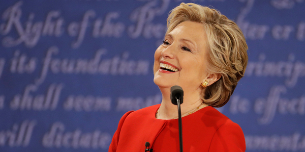 Not all serious: Democratic presidential nominee Hillary Clinton has a laugh during the presidential debate. Photo / AP