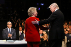 Democratic presidential nominee Hillary Clinton and Republican presidential nominee Donald Trump shake hands during the presidential debate at Hofstra University. Photo / AP