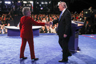Democratic presidential nominee Hillary Clinton shakes hands with Republican presidential nominee Donald Trump after the presidential debate at Hofstra University. Photo / AP