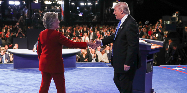 Loading Democratic presidential nominee Hillary Clinton shakes hands with Republican presidential nominee Donald Trump after the presidential debate at Hofstra University. Photo / AP