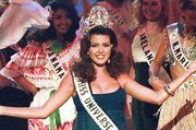 The 1996 reigning Miss Universe, Alicia Machado of Venezuela, joins in the opening number during the 1997 Miss Universe Pageant in Miami Beach Friday, May 16, 1997. (AP Photo/Hans Deryk)