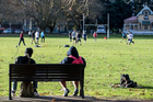 People enjoy the winter sun at Victoria Park. New Zealand Herald Photo Michael Craig.