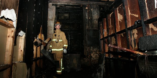 Firefighter Mike Maguire walks through the burnt-out shell of the St James after a fire in 2007 almost destroyed the iconic landmark. PHOTO/CHRIS SKELTON
