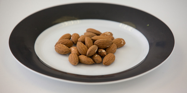 They may be high in calories, but Lily points to scientific studies which show that almonds may help us to lose weight. Photo / Dean Purcell