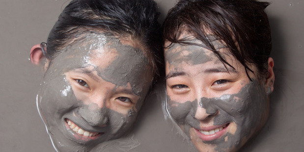 Nicole Zheng, left, and Sherry Liu, from China at Hell's Gate thermal mud pools. Photo / Stephen Parker