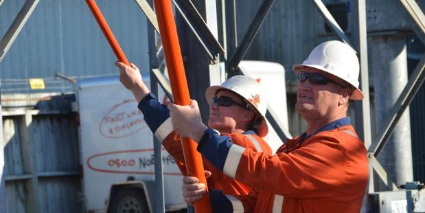 Michelle Burke and her partner, Neville Knight, at work for lines company Northpower. Photo / Supplied
