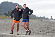 SURF'S UP: Big Dyls (Dylan Cossey), right, from The Block NZ is selling himself for surf lessons, to raise money for a cause close to home. Apprenctice Dylan Guitinck, left, will also be there. PHOTO/GEORGE NOVAK