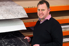 Heritage Hardware's Dion Fyfe  shows off laminate surfaces with digital stone images.