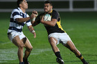 Losi Filipo of Wellington tries to get past TJ Vaega of Auckland A during the Jock Hobbs Memorial Under 19 Rugby Graham Mourie Cup. Photo / Getty Images.