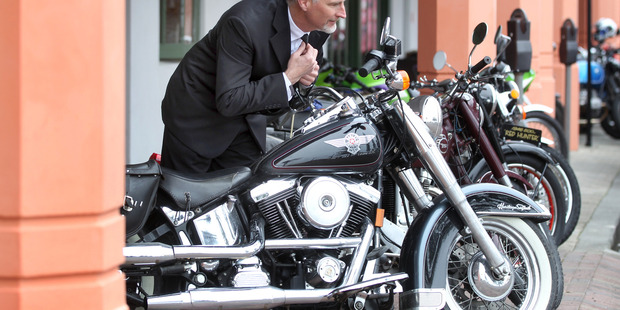 Brent Stiver from Hastings pauses to straighten his tie in the mirror of a Harley-Davidson Heritage Softail, borrowed to take part in yesterday's Ride.  PHOTO/ Duncan Brown.