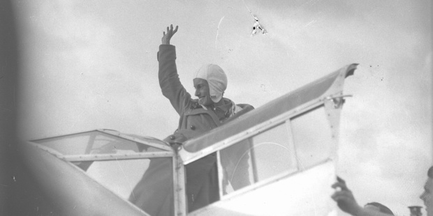 Jean Batten arrives from Britain at Mangere Aerodrome Batten waving from cockpit in 1936. Photo / Herald files
