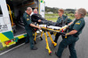 Northland intensive care paramedic Mark Going (left) helps to load Rural Contractors New Zealand national president Steve Levet, along with Bream Bay emergency medical technicians Barb Lock and Inga Knier. PHOTO/JOHN STONE