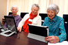 Tutor Barbara Budgen (centre) with students Joyce Abercrombie (left), aged 82, and Lindsay Faber,  aged 93, who have graduated from a Senior Net computer course. Photo/John Stone