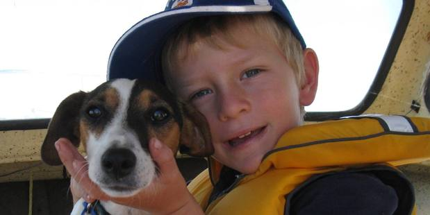 REUNITED: Missing dog Possum, pictured with Elliott Stachurski, has been found and is back home.