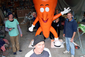FINAL FIX: Sculptor Mike Walsh puts the finishing touches to the cartoon vegetables that will grace the Ohakune Carrot Adventure Park, with help from Brett McCarten (left) and Fred McKelvey (right). PHOTOS/STUART MUNRO