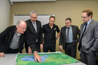 Sunfruit MD John Altham,, Hastings Mayor Lawrence Yule, Sunfruit GM Tim Altham and HDC strategic projects manager Raoul Oosterkamp look at plans for the new development.