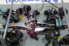 Life for pit stop mechanics on the Formula One circuit is very stressful. Photo / AP