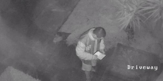 CCTV footage of a man with the iPad he took while stealing from a Pakuranga home on Friday morning. PHOTO / SUPPLIED